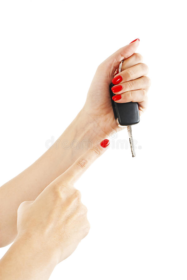 A woman's hand holds car keys. Isolated on white background stock images
