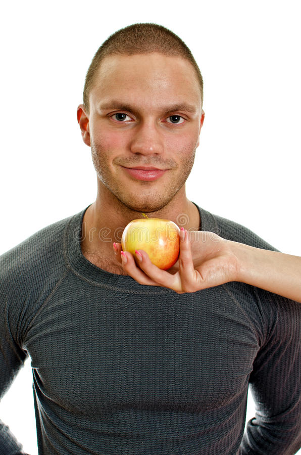 Download Woman's Hand Offering An Apple To Man. Stock Photo - Image: 25686344