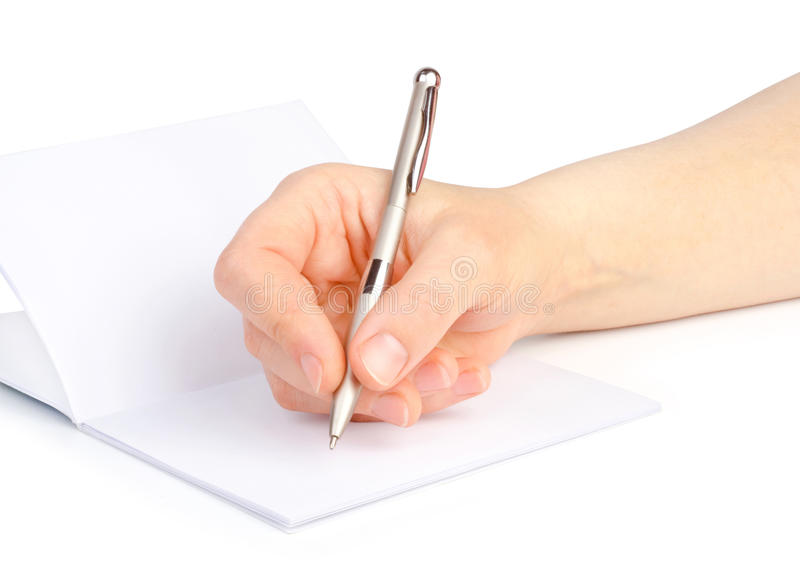 Woman's hand with a pen writes in a notebook isolated stock image