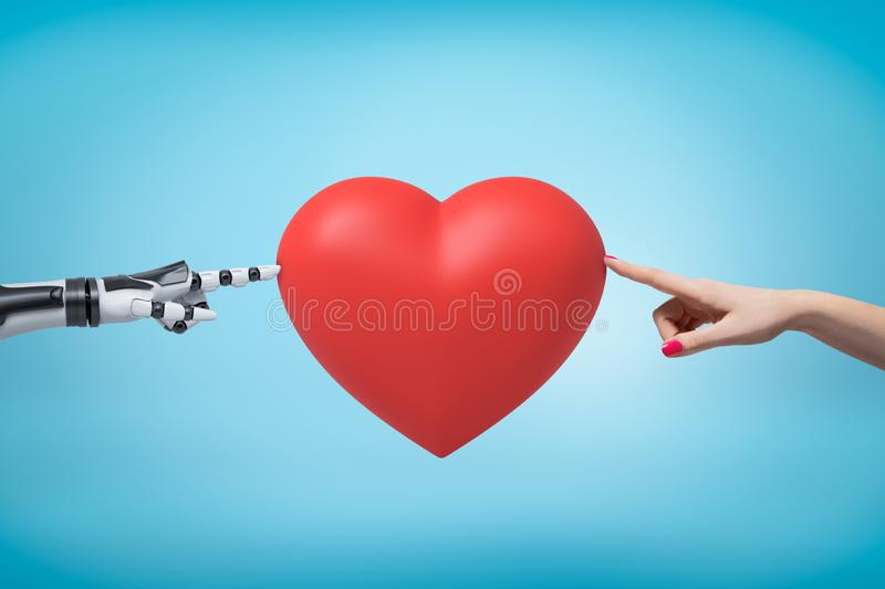 Woman`s hand on the right and robot`s hand on the left touching red Valentine heart with their fingertips. royalty free stock image
