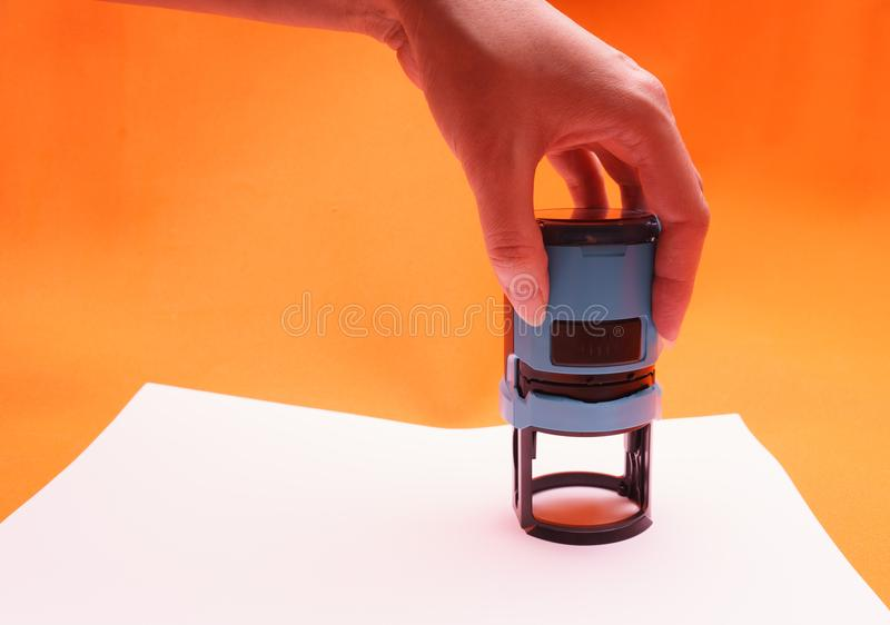 Woman`s hand with the seal, stamp. Process stamping the contract, documents, close up. stock illustration