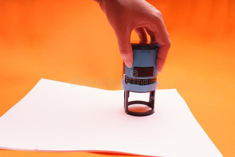 Woman`s hand with the seal, stamp. Process stamping the contract, documents, close up. vector illustration