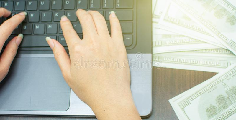 Woman& x27;s hand typing keyboard for making money calculation royalty free stock photos