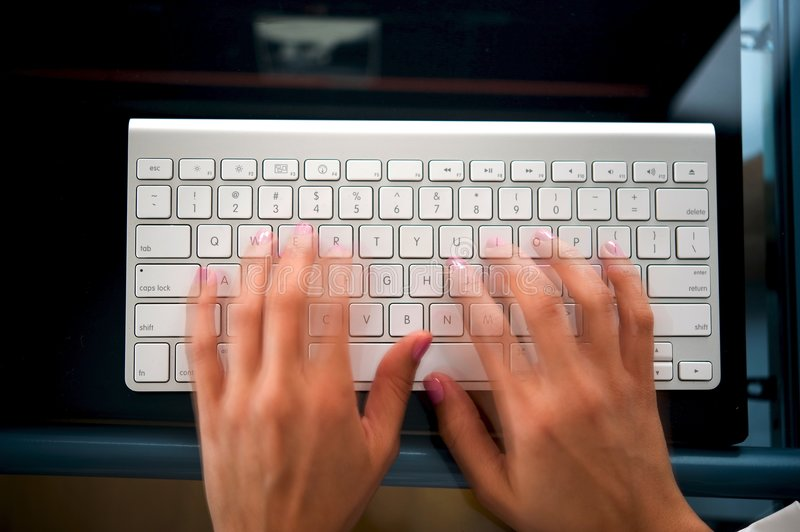 Woman's hands on a computer keyboard stock image