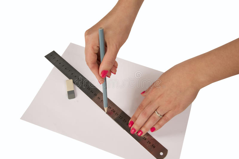 Woman's hands drawing line with pen and ruler stock photography