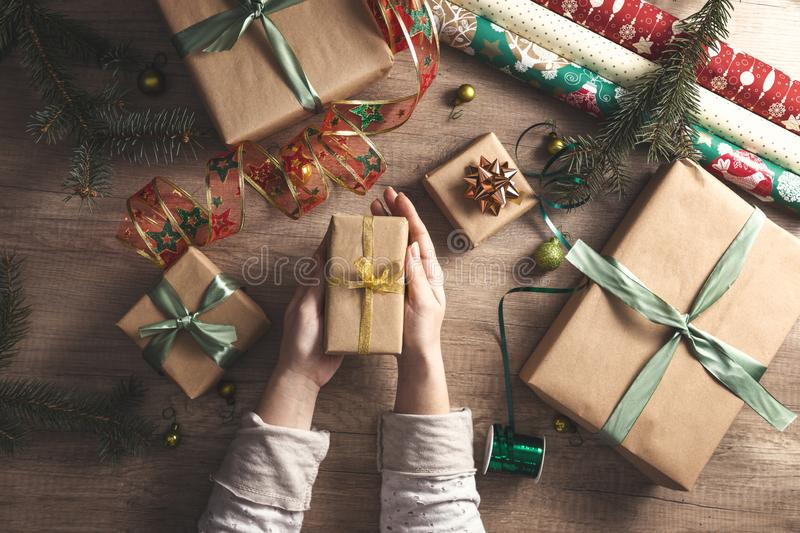 Woman`s hands give wrapped Christmas royalty free stock images