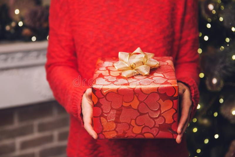 Woman`s hands holding Christmas or New Year decorated gift box. stock images