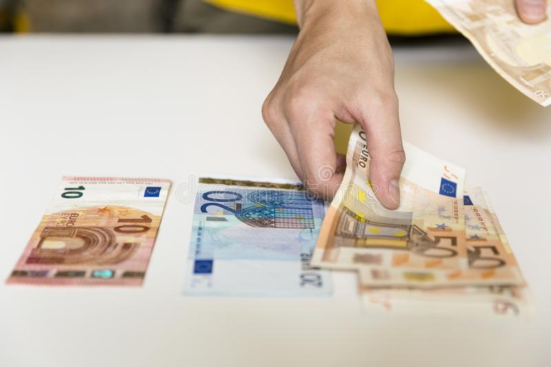 Woman`s hands holding and counting European Euro bills. Wealth, stock photos