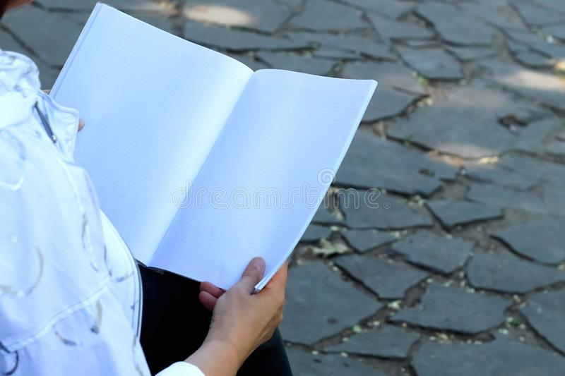 Woman `s hands holding notebook stock photo