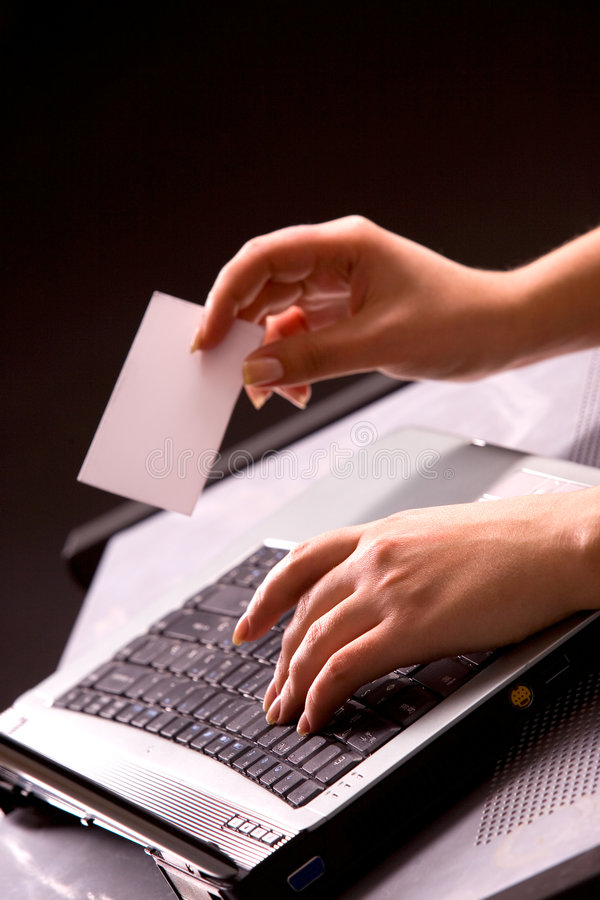 Woman's hands with keybord and business card. Young woman's hands with computer keybord and business card stock images