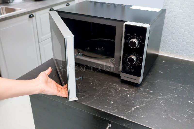 Download Woman`s Hands Open Microwave Door Stock Photo   Image Of  Commercial, Appliance