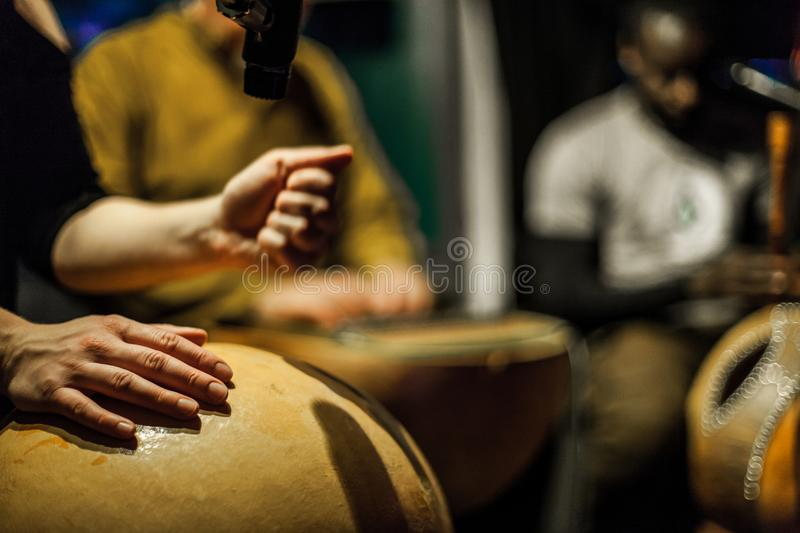 Lady playing calabash drum on stage stock photos