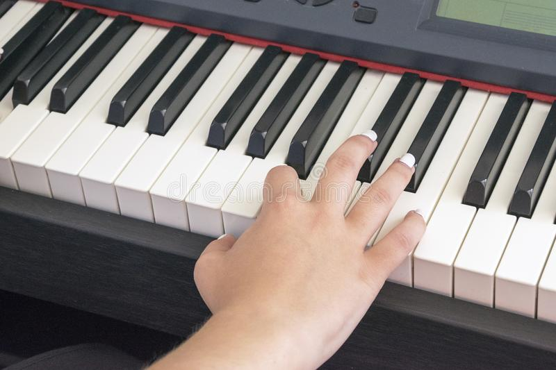 Woman`s hands playing on electric piano stock images