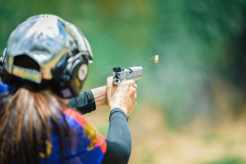 The woman`s hands are practicing firing guns and shelling out. royalty free stock photos