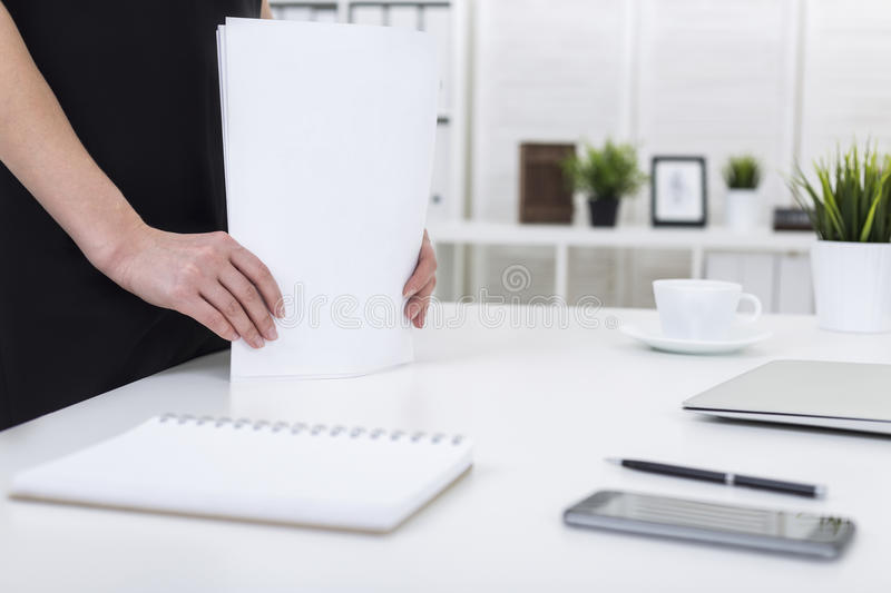 Download Woman`s Hands With Stack Of Papers Stock Photo - Image: 83722824