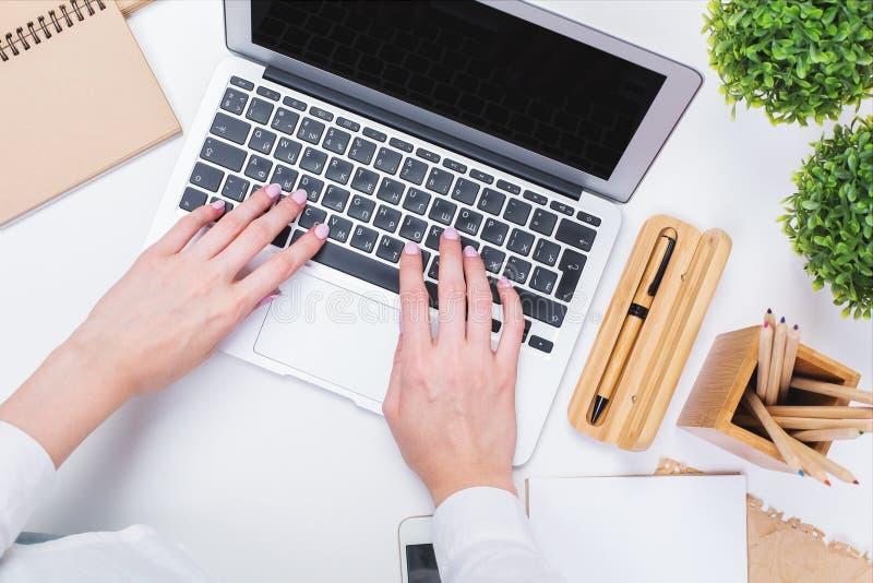 Woman's hands using laptop closeup stock image