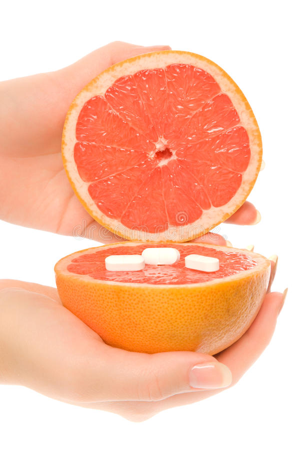 Free Woman S Hands With Two Pieces Of Grapefruit Royalty Free Stock Image - 12687176