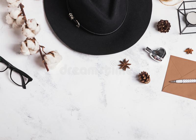 Woman`s hat, glasses, cotton branch and other small objects royalty free stock images
