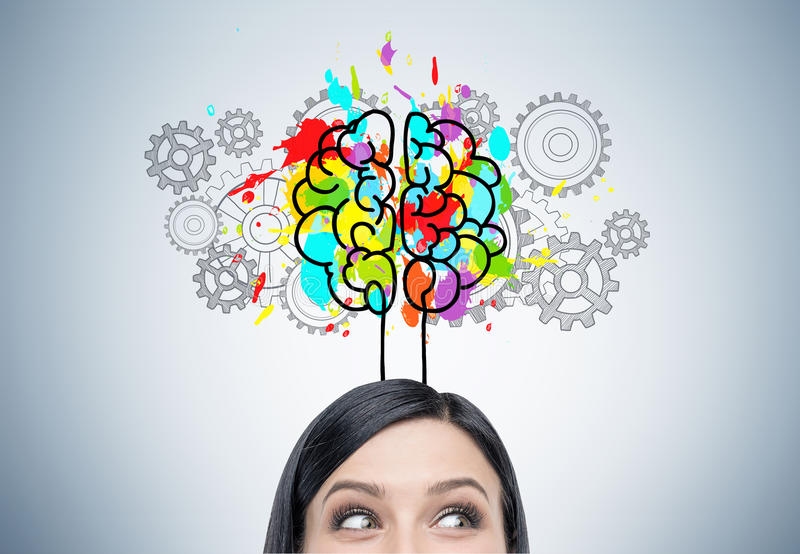 Woman s head, brain and cogs. Close up of a woman s head with black hair. She is standing near a gray wall with a colorful brain sketch surrounded with gears