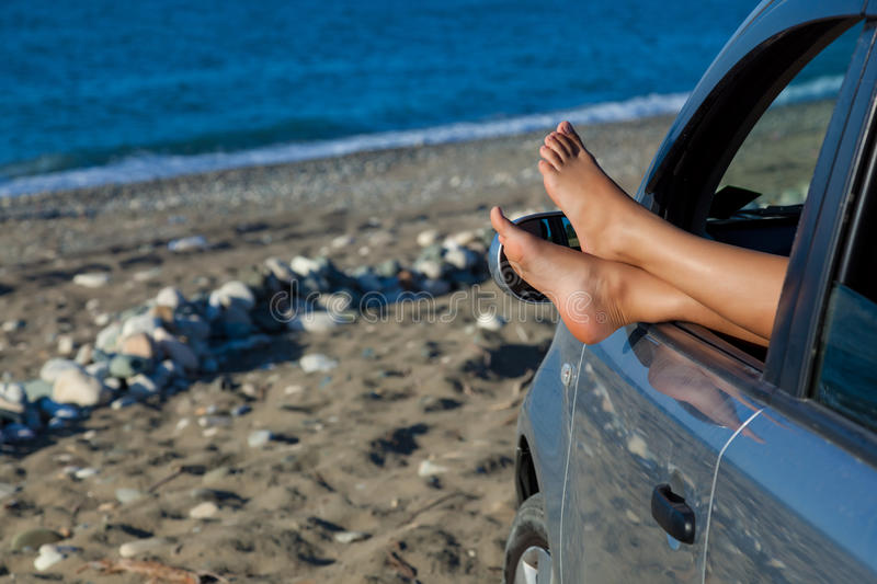 Download Woman's Legs Dangling Out A Car Window Stock Photo - Image: 28725242