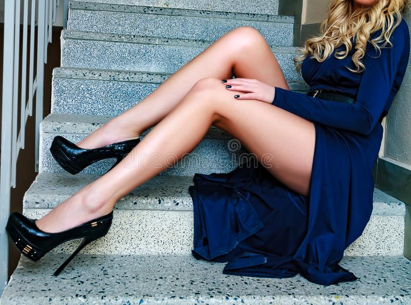 Woman`s legs on a stairs royalty free stock image