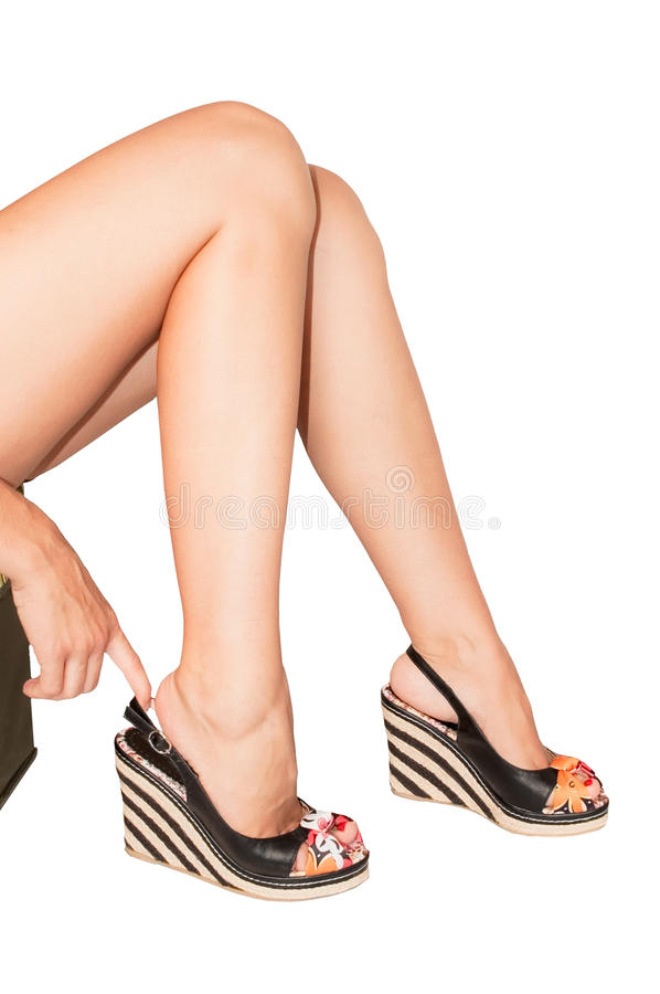 Woman's legs with summer shoes royalty free stock images