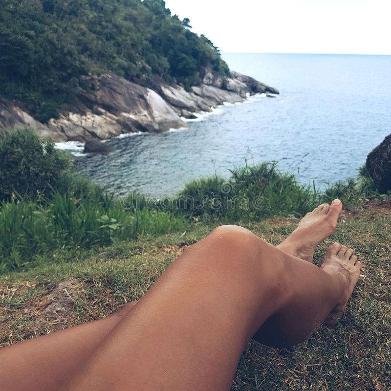 Woman& x27;s legs and view on the sea royalty free stock images