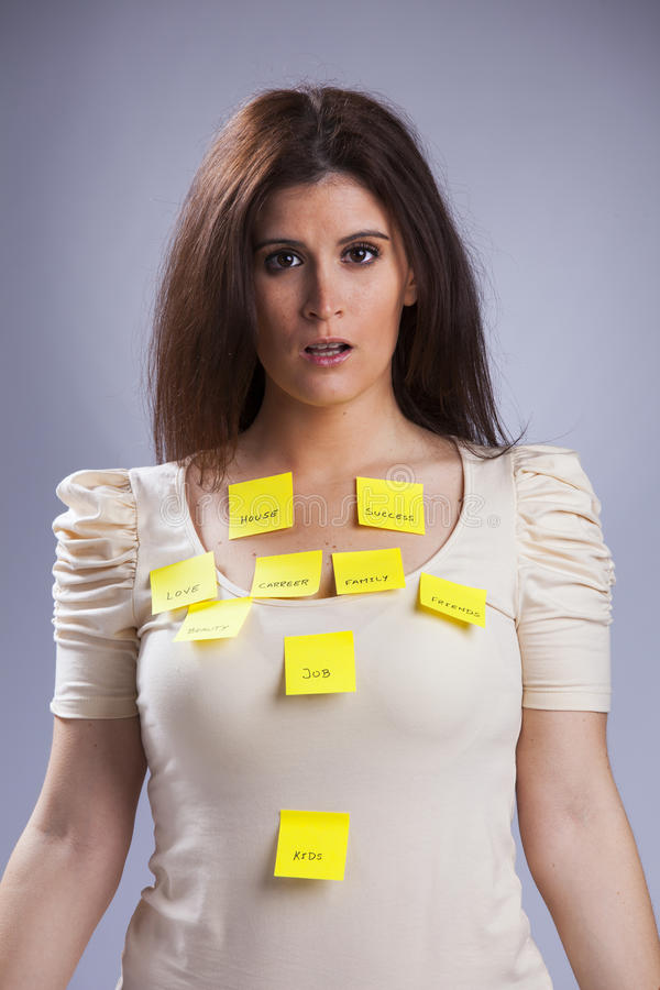 Woman's life problems. All the things that worries a young woman royalty free stock photo