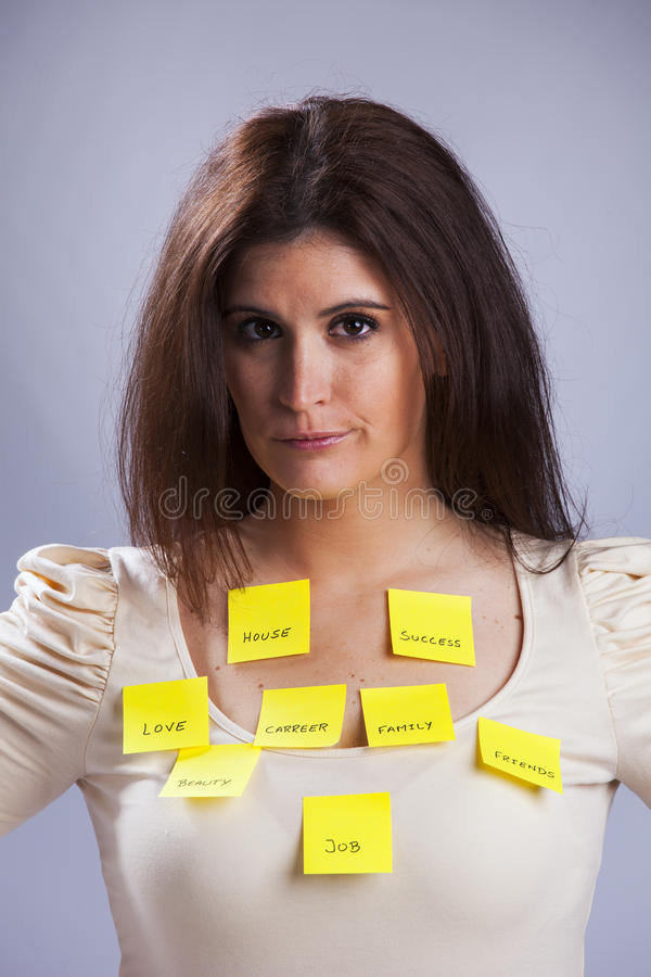 Woman's life problems. All the things that worries a young woman stock photography