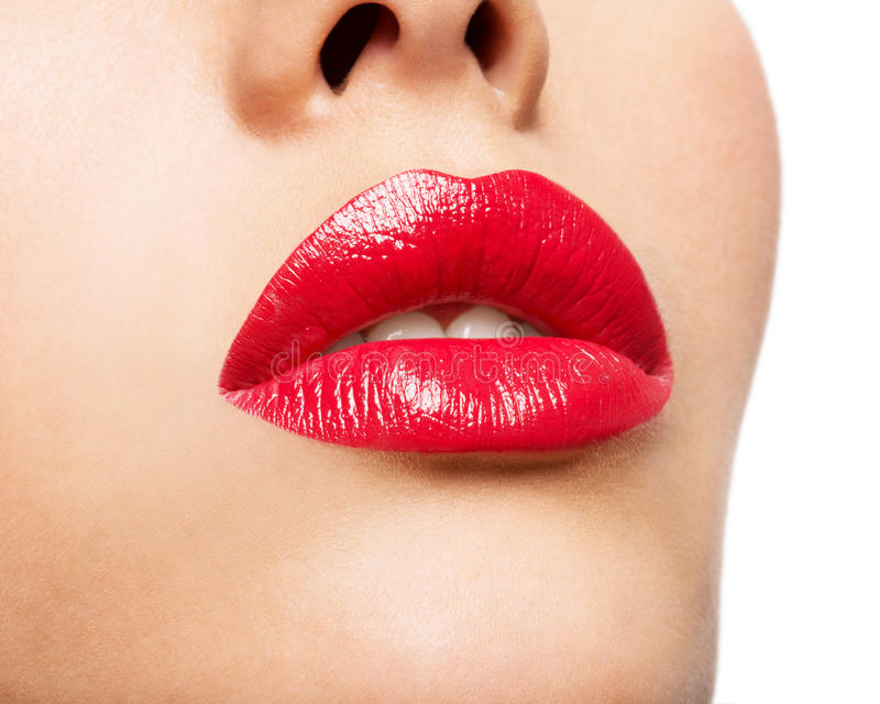 Woman's lips with red lipstick. Glamour fashion bright gloss make-up royalty free stock images