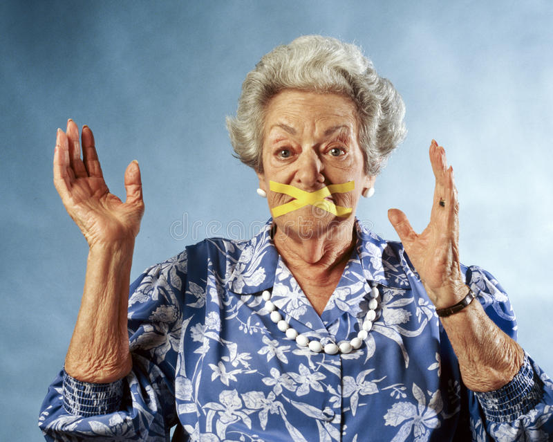 Woman's mouth taped royalty free stock photography
