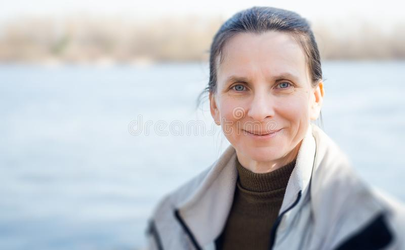 Woman`s Portrait Close to the River stock image