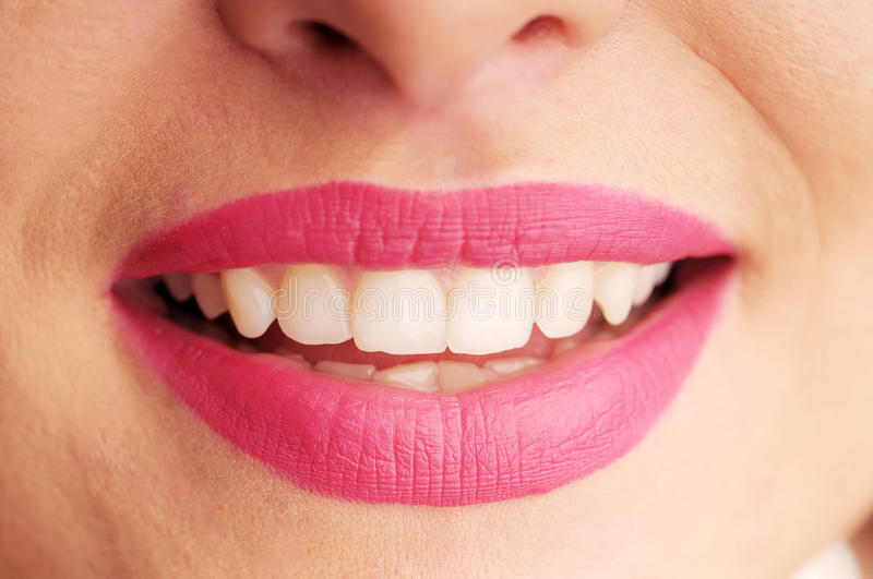 Woman's seductive lips with pink lipstick stock image