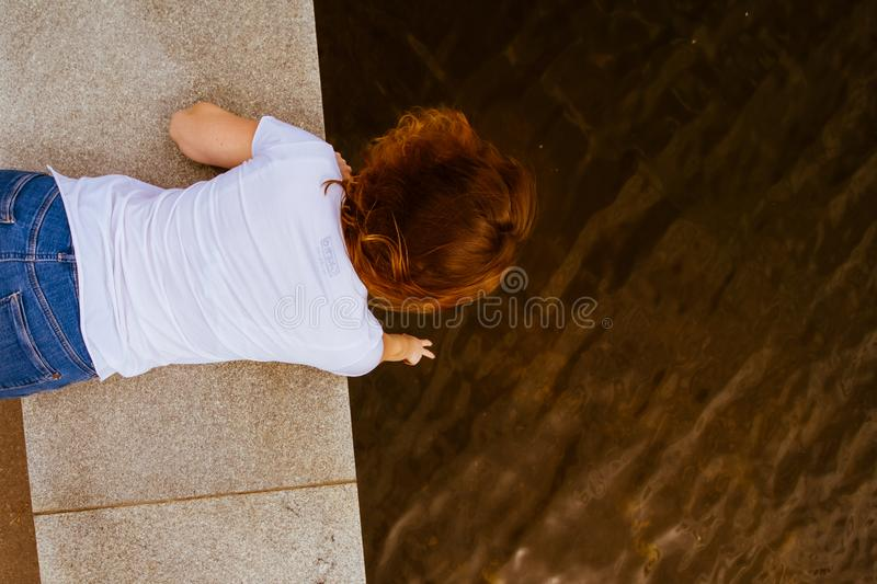 woman 20s with short red hair in white clothes on the embankment stock photography