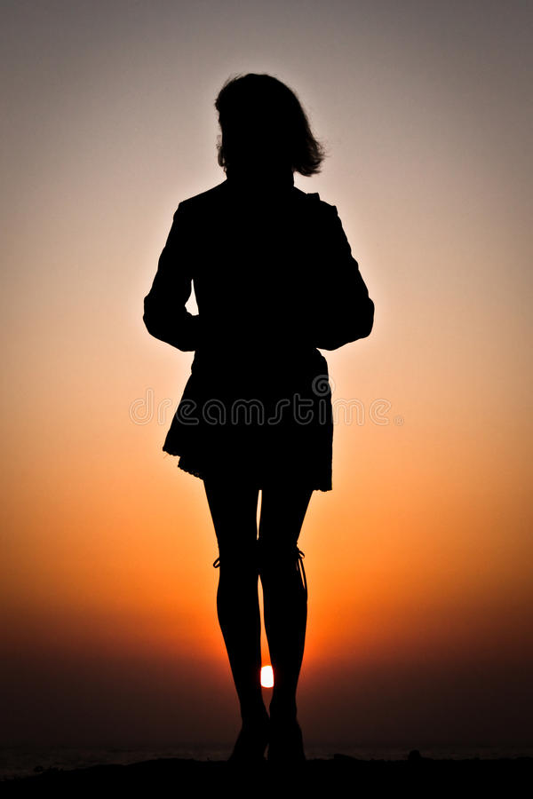 Woman's silhouette on the beach royalty free stock images