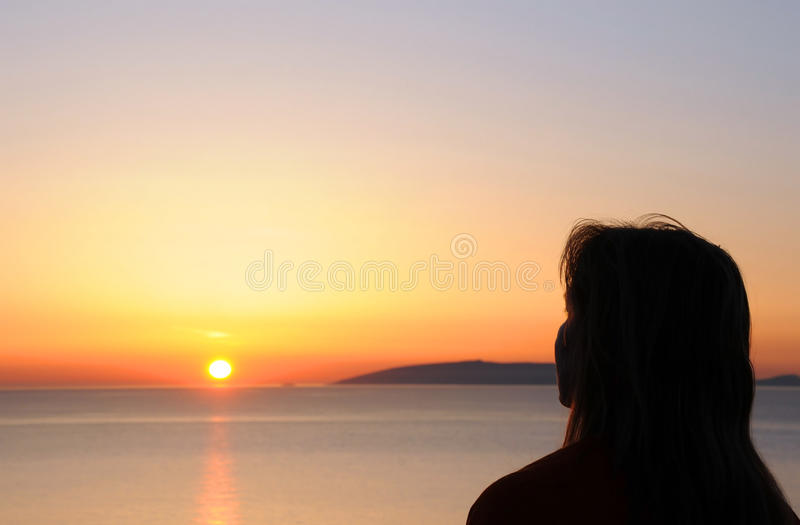 Download Woman's Silhouette At Sunrise Stock Photo - Image: 26649076