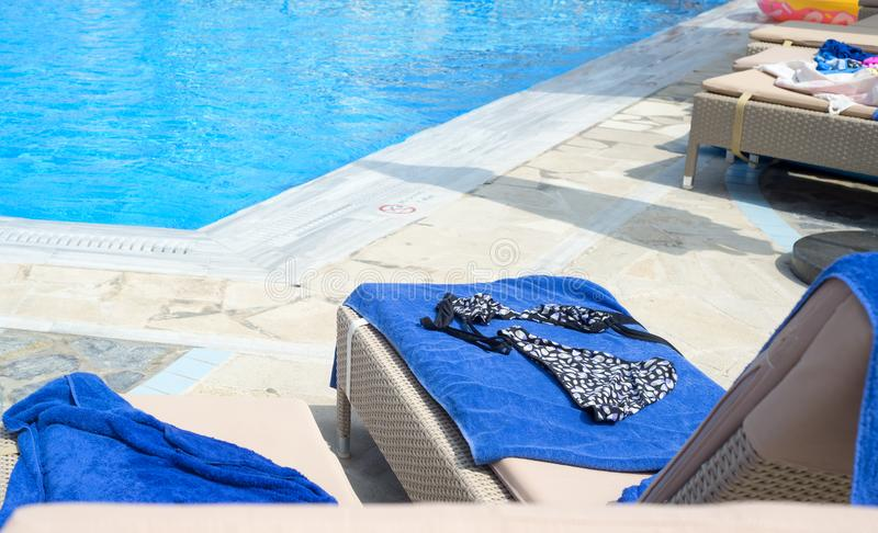 Woman`s swimming suit on a sun bed royalty free stock photos