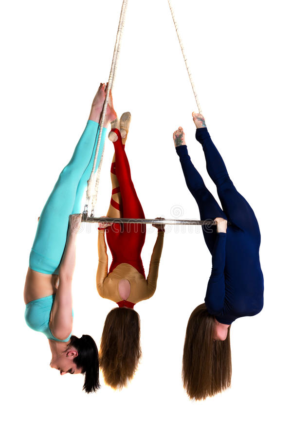 Woman`s trio on aerial luster stock photo