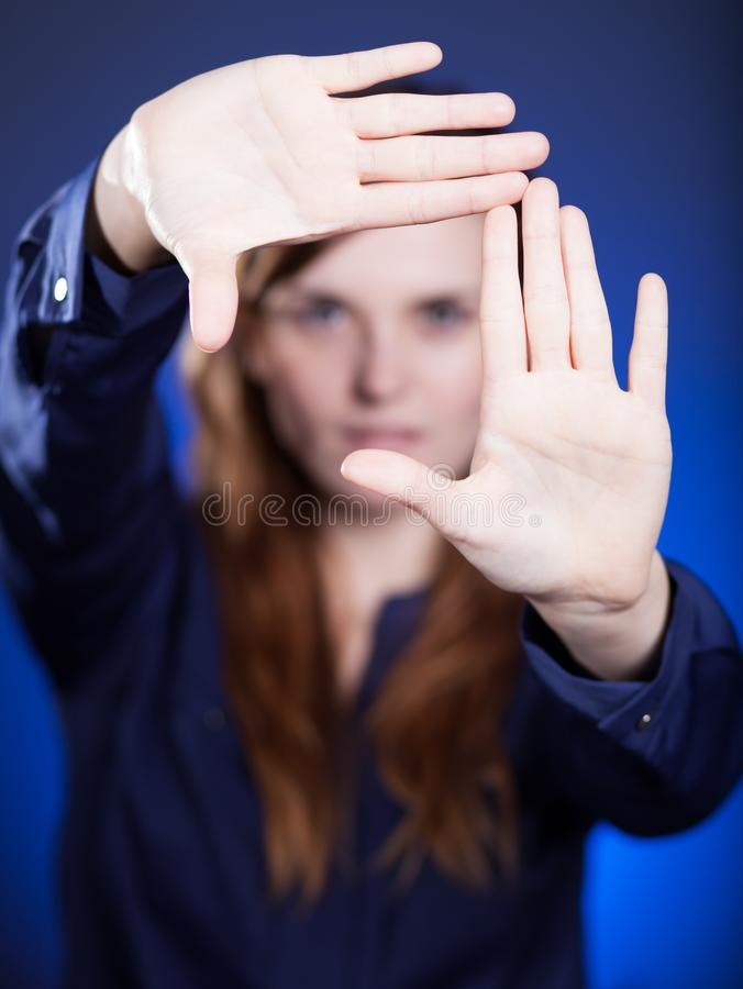 Woman's two hands framing composition, forming space stock image