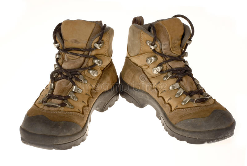 Woman's Well Worn Hiking Boots, Isolated. A pair of well worn women's hiking boots isolated on white stock images