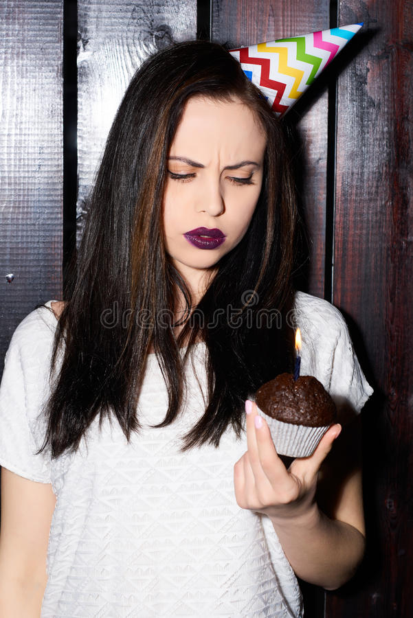 Woman is sad holiday on the background black wood. stock image