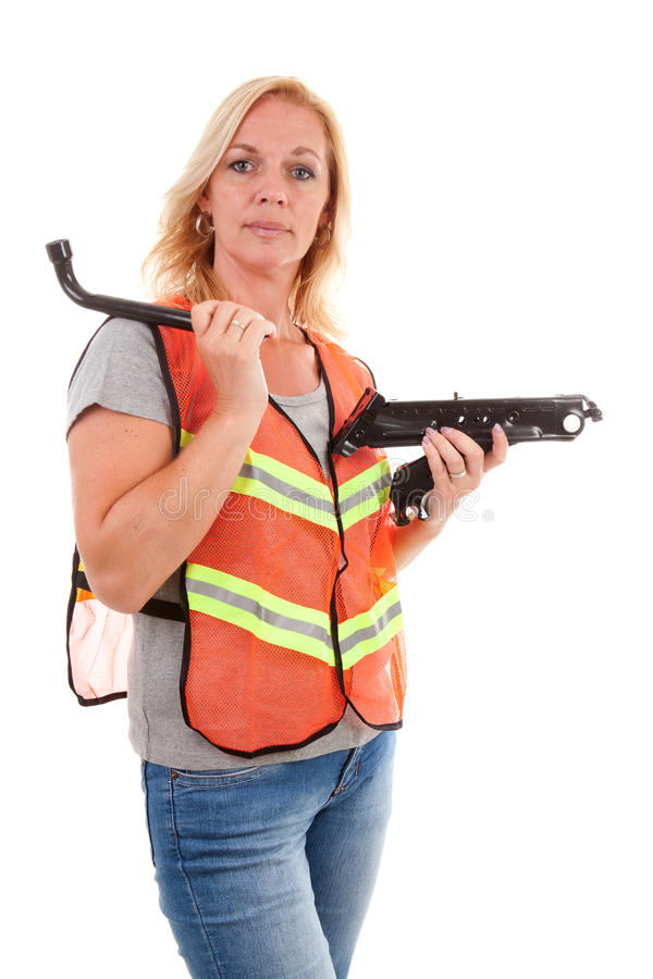 Woman in safety vest. Holding car breakdown jack over white background stock photo