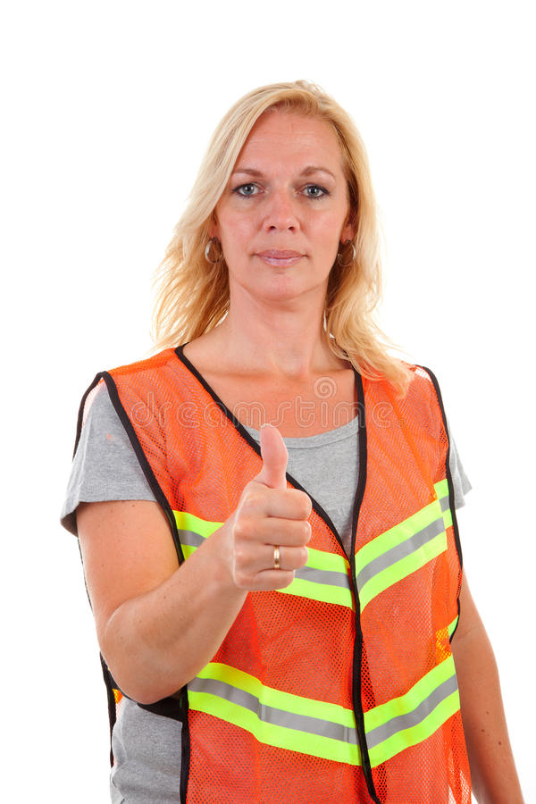 Woman in safety vest stock image