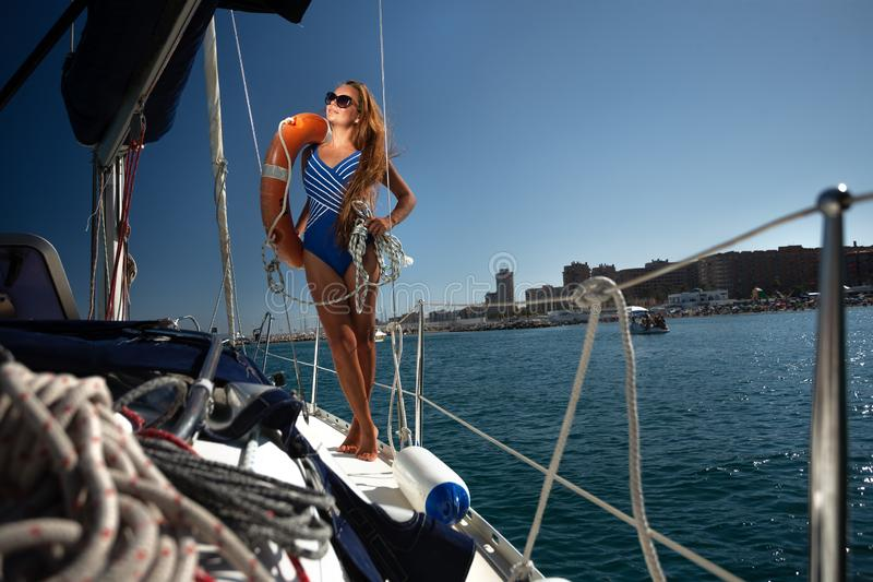 Woman on sailing yacht on the sea royalty free stock photo