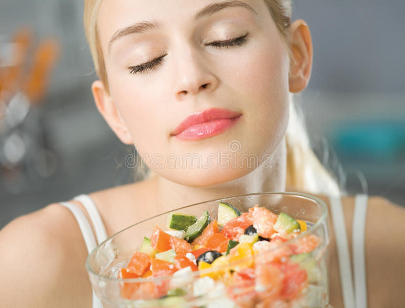 Woman with salad. At home stock image