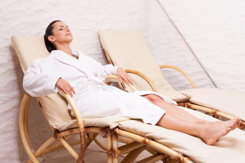Woman in salt room. royalty free stock image