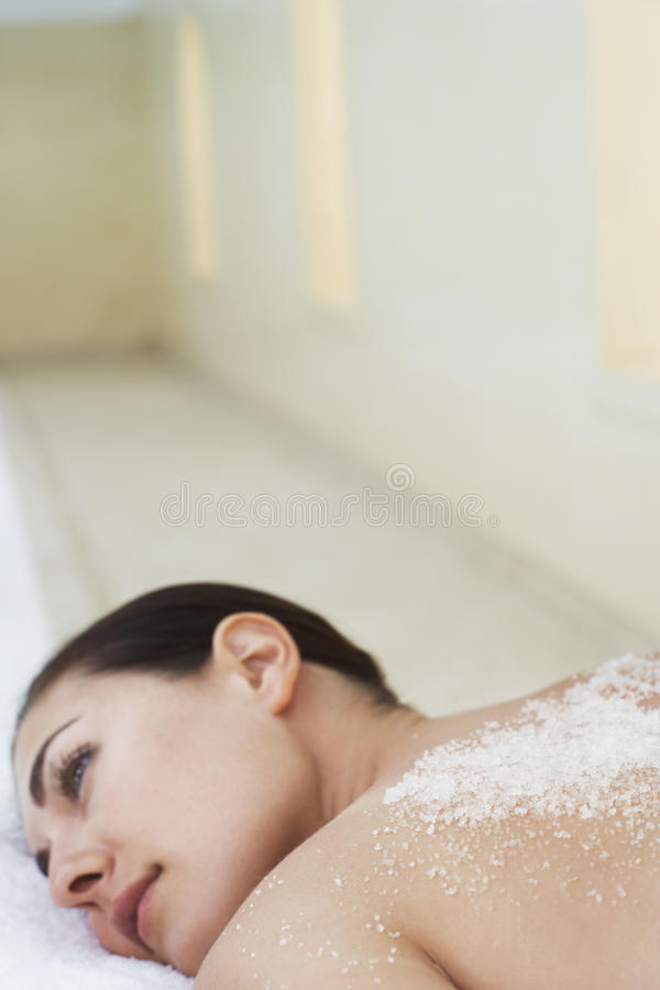 Woman With Salts On Back At Spa stock images