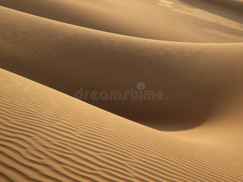 Download Woman in sand stock photo. Image of shadow, heat, wind - 34246988