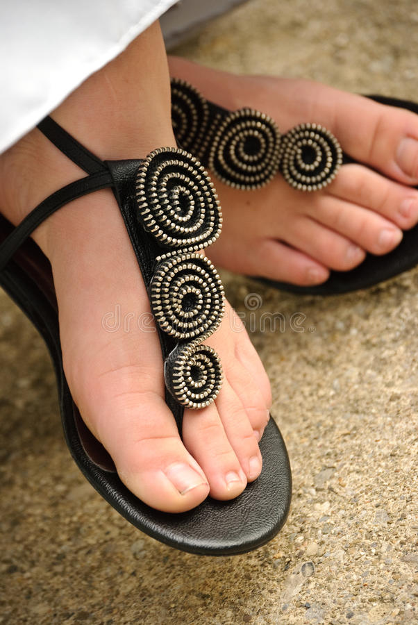 Woman sandals. A woman wearing a pair of sandals stock photography