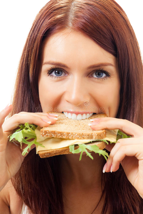 Woman with sandwich. Woman eating sandwich, isolated on white royalty free stock image